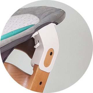 Sistema de fijación de la hamaquita para bebés en la trona